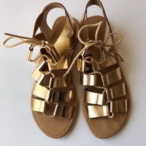 City Classified Gold gladiator sandals